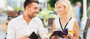 date, people, payment and financial independence concept - happy couple with cash