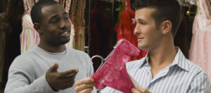 Multi-ethnic men shopping for lingerie